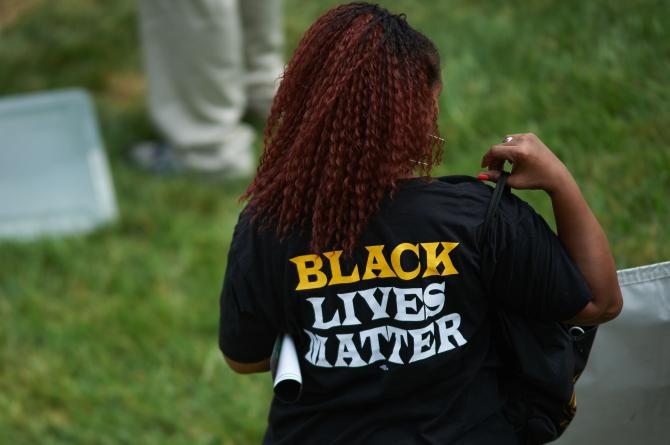483504336-woman-wears-a-shirt-with-black-lives-matter-during-a.jpg.CROP_.rtstoryvar-large